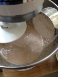 After adding the sponge and mixing a bit, I add the flour, 1/2 cup at a time, using the dough hook and the mixer set on low