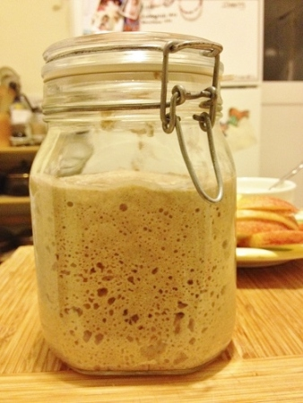 Nearly two hours later, the starter bubbles high in the jar