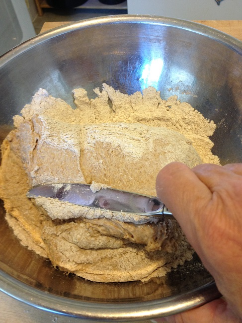The dough absorbs a little flour with each turn of the knife