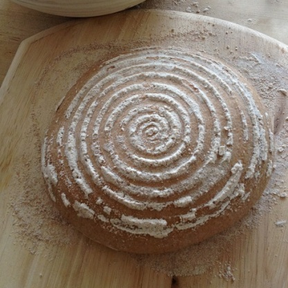 The boule, inverted from the proofing basket onto the pizza peel