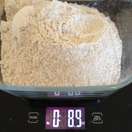 Only 8.9 ounces flour, to compensate for the 1.1 ounces rye flakes added earlier