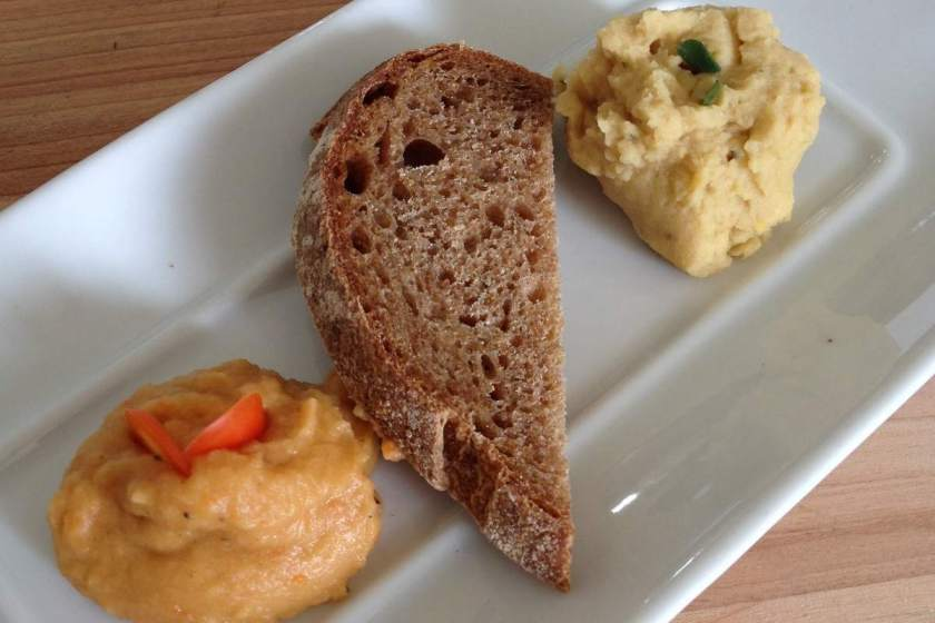 Homemade Lemon Thyme Hummus with whole wheat sourdough bread and Chopotle and Roasted Red Pepper Hummus