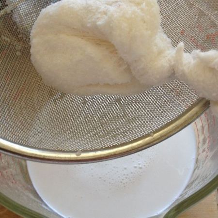 Squeezing the liquid from the cheesecloth