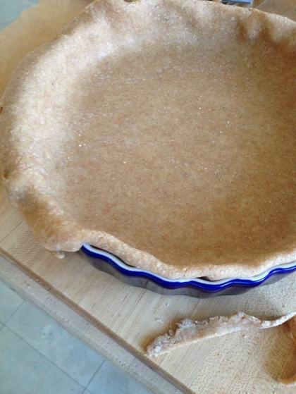 Folding the edge of a whole wheat tart crust