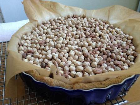 Let the beans cool before lifting them from the pie plate