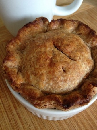 An apple tartlett made with scraps of pie dough