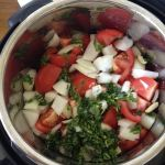 Chopped veggies in the pot, ready to stew fast under pressure