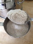 Spooning the whole wheat flour into a measuring cup aerates it