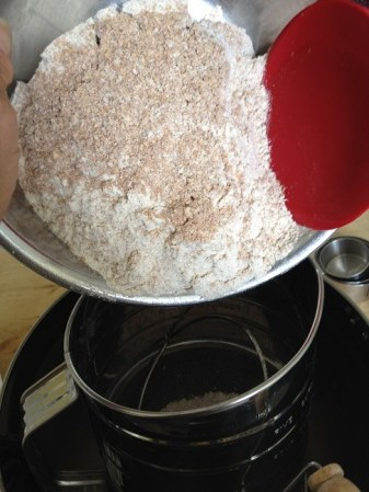 Dump the bran into your bowl with the sifted flour, then pour it all back into the sifter