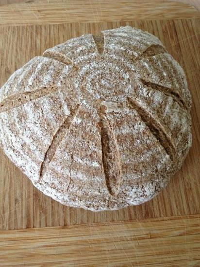 Whole wheat sourdough loaf, ready to cut and eat