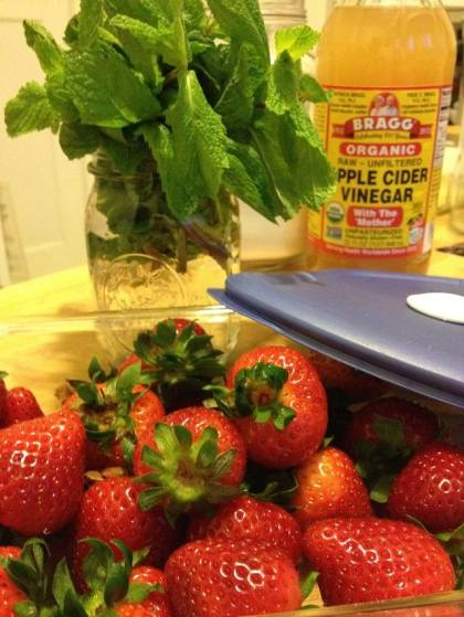 Store the berries in a glass container and the herbs in a jar of water in the fridge