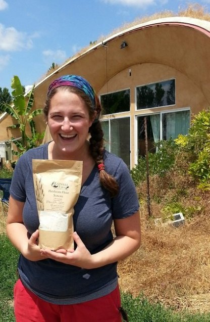 Emily, CSA manager and events coordinator at Eatwell Farm, with a bag of freshly-milled whole wheat Sonora flour