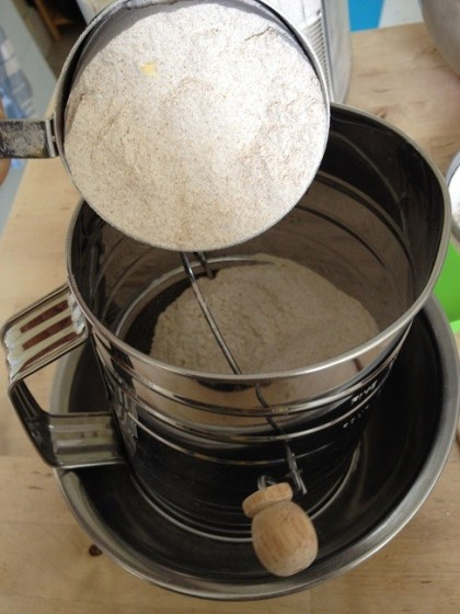 Pour the measured flour into the sifter
