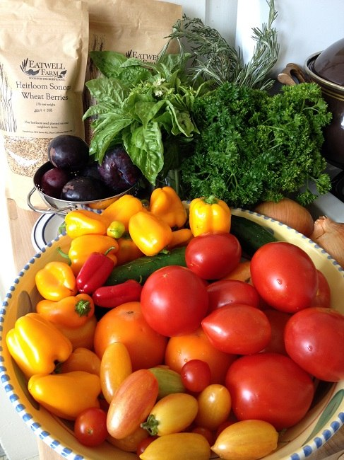 Tomatoes, lunch box peppers, cucumbers, plums, onions, parsley, rosemary and sweet basil from Eatwell Farm