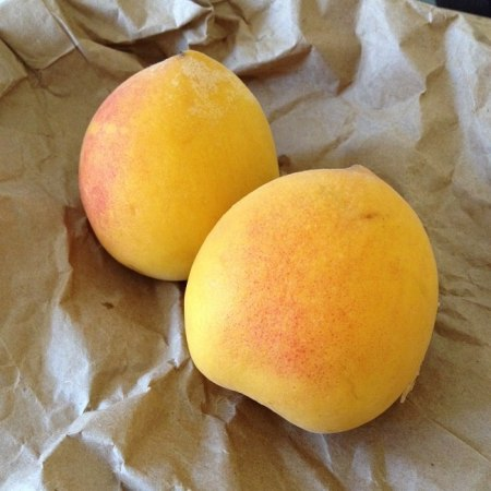 8 days later, the two hardest, greenest peaches glowed with color and felt squeezably soft