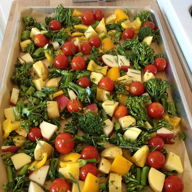 Tray ready for the oven with probably too many vegetables and lots of rosemary leaves