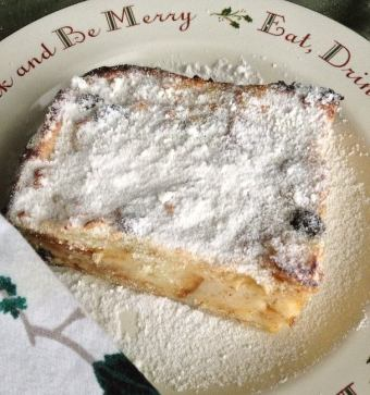 Sure, why not let your 3-year-old have a little fun dusting her piece of bread pudding with powdered sugar?