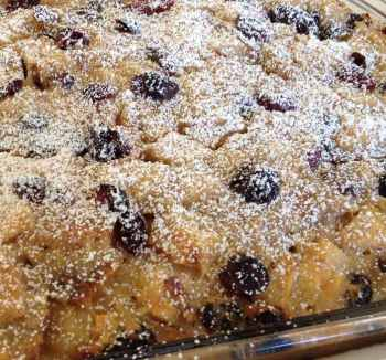 Zesty bread pudding, warm from the oven and lightly dusted with powdered sugar