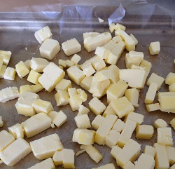 Spread the cubes on a parchment-lined pan