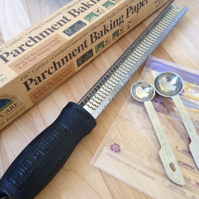 Baker's parchment, zester, baggie and two measuring spoons