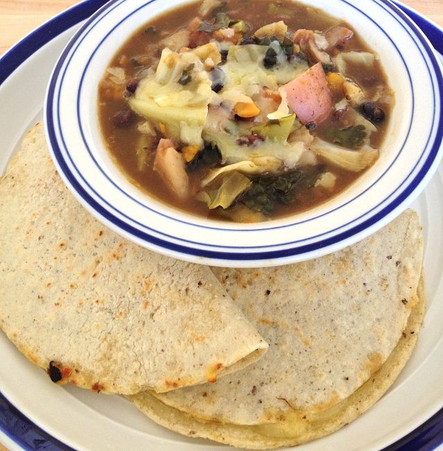 Black bean and cabbage stew with crescent quesadillas