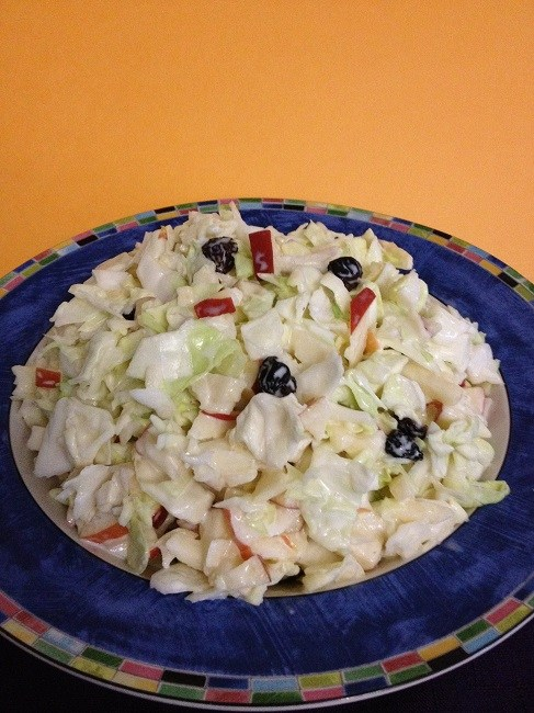 Chopped slaw with apples, raisins and a bit of minced onion, dressed in a tangy yogurt-citrus dressing