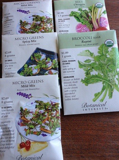 Seed packets of Micro Greens Mild Mix, Micro Greens Spicy Mix, Chioggia beets and Broccoli Raab