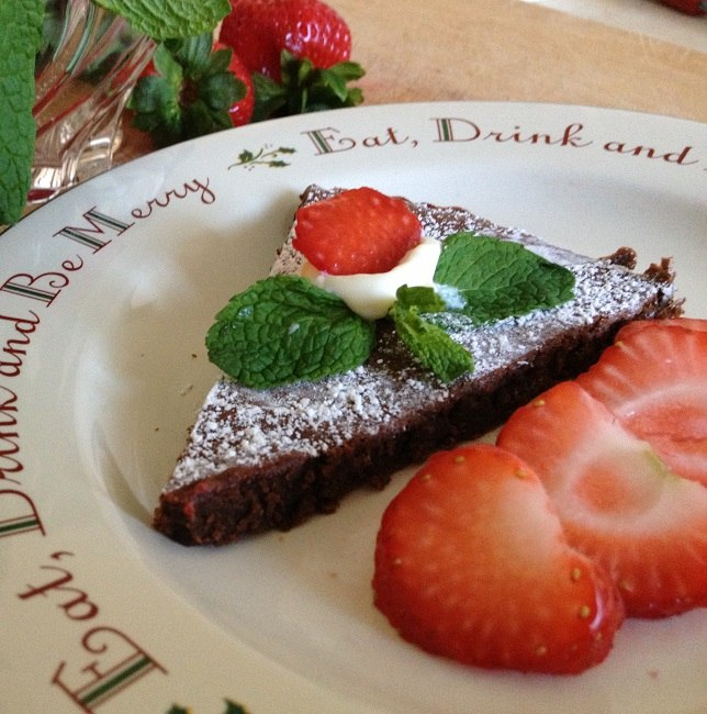 Chocolate almond torte with strawberies, mint and mascarpone