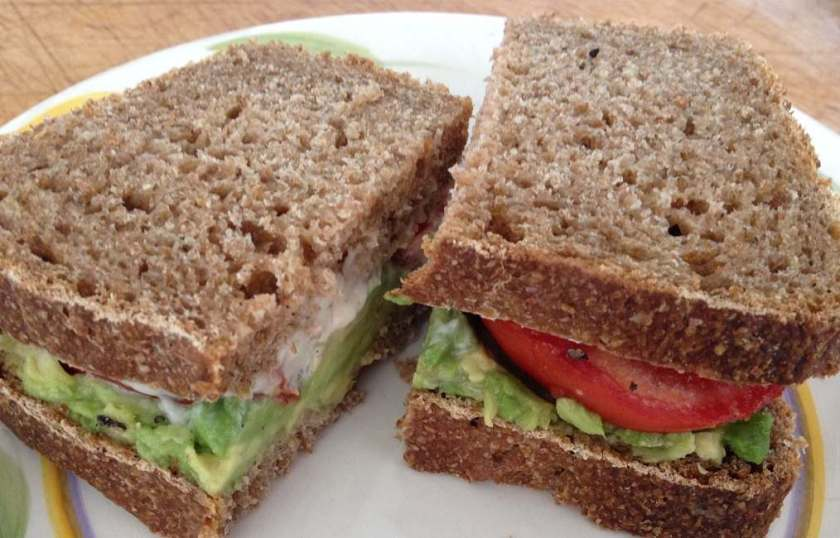 Tomato avocado sandwich on homemade whole wheat bread