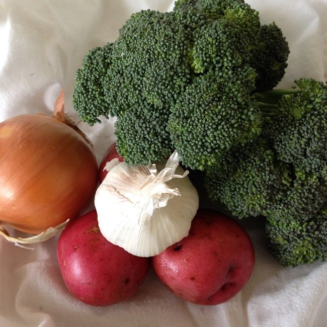 1 medium onion, three small, new red potatoes, a bunch of broccoli and a bulb of garlic