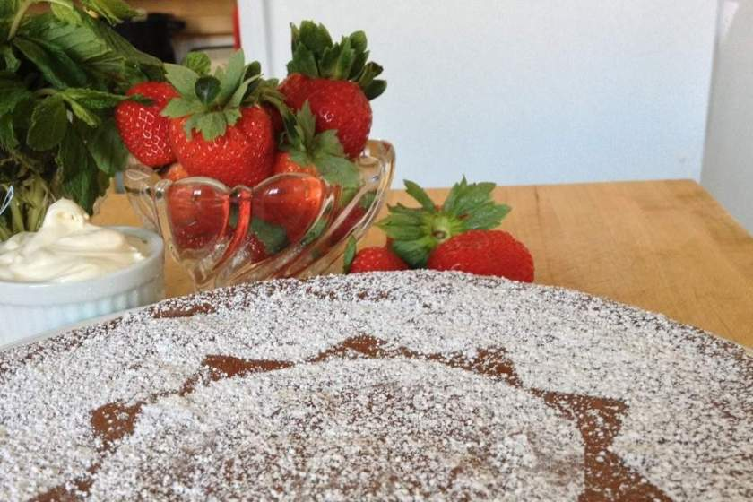 Mascarpone, strawberries and chocolate almond torte, dusted with powdered sugar