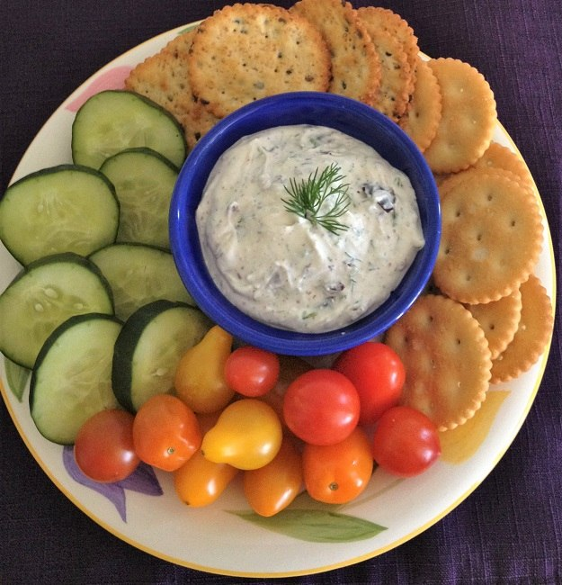Olive herb dip with crackers and crudites