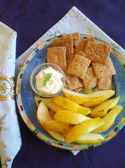 The basic dip, garnished with a sprig of mint, is as tasty with fresh-cut pears as it is with homemade whole wheat crackers