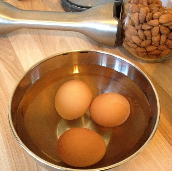 Bring eggs to room temperature quickly in bowl of warm water
