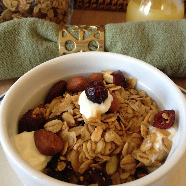 Orange juice and half a cup of our Maple Almond Granola over half a cup of plain yogurt from grass-fed, pastured cows