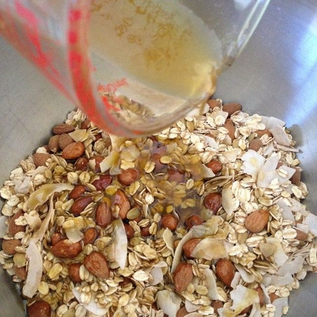 Pouring the syrup mixture over the oat combo