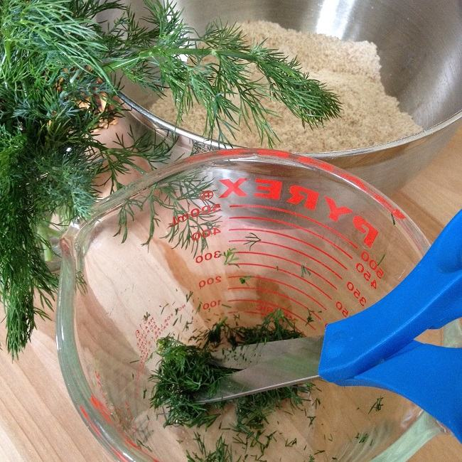 Snipping dill to add to the pie crust flour mixture