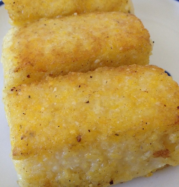 Lightly fried polenta wedges, the polenta made fresh this morning with nothing more than stone ground corn meal, water and a little salt