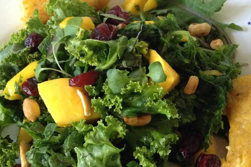 Mango kale salad with toasted peanuts, dried cranberries, organic micro greens and spicy red onion