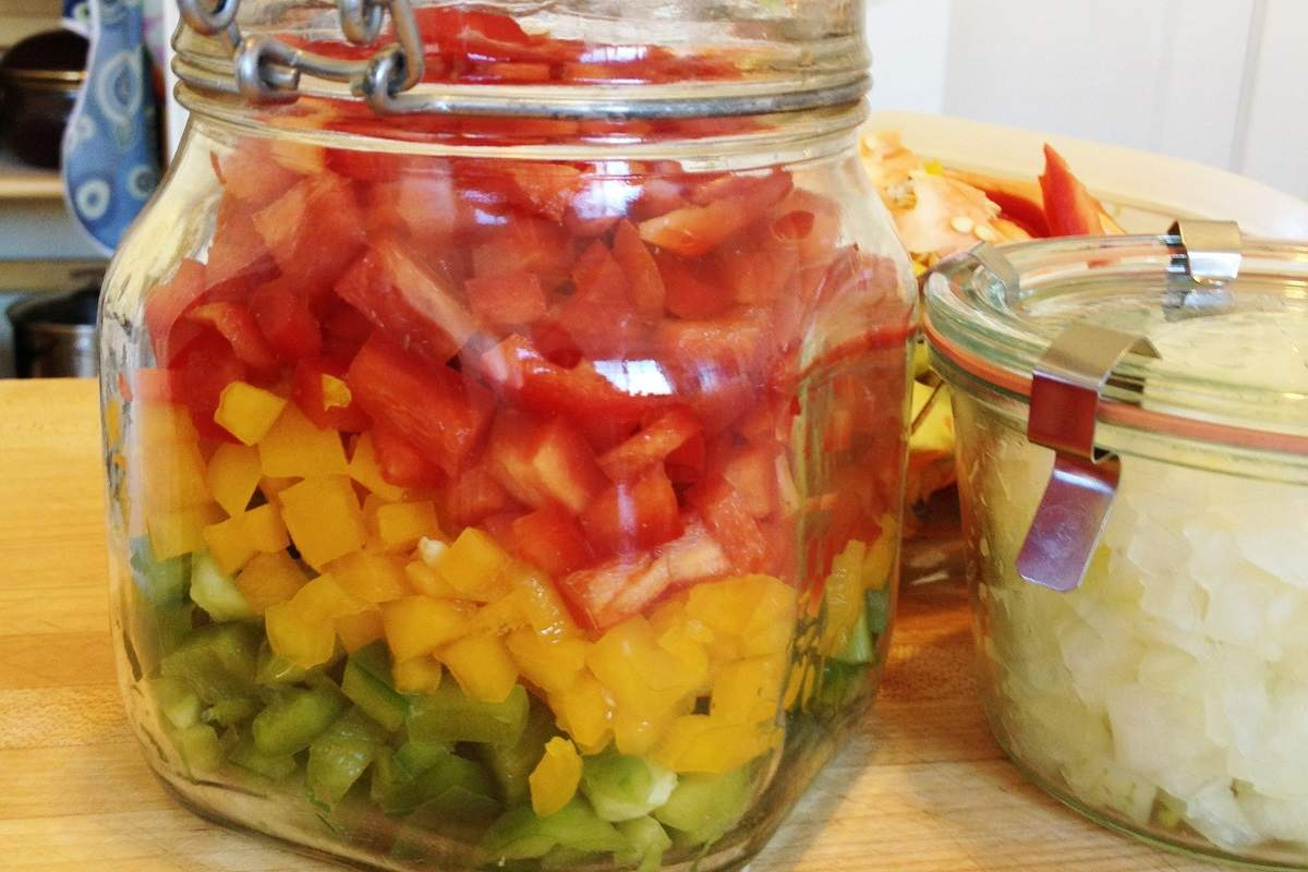 Chopped bell peppers and onions, ready for quick meals