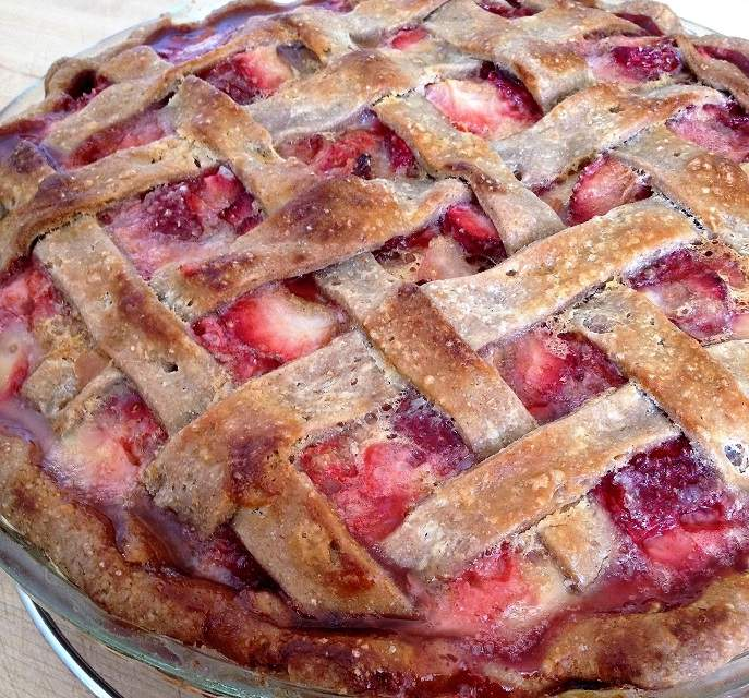 Strawberry rhubarb custard pie in whole wheat lattice crust, just out the oven and still bubbling